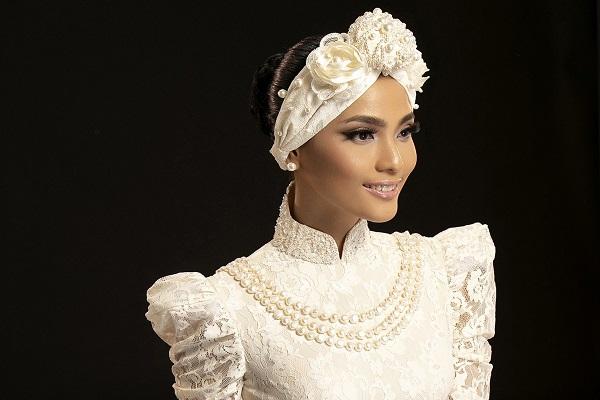 Trương Thị May đẹp cuốn hút khi kết hợp áo dài trắng với khăn Turban